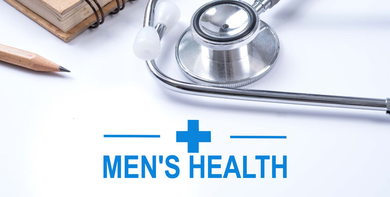 Stethoscope, notebook and pencil with men's health words
